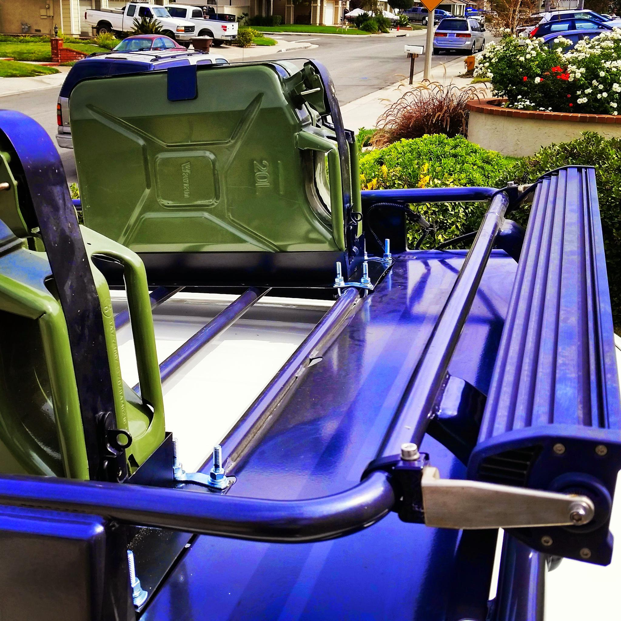 Jerry can holder mounted on arb roof rack img_20140921_115550 jpg